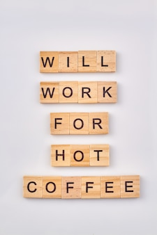 Abstract idea of coffee break. will work for hot coffee. quote written with wooden blocks isolated on white background.