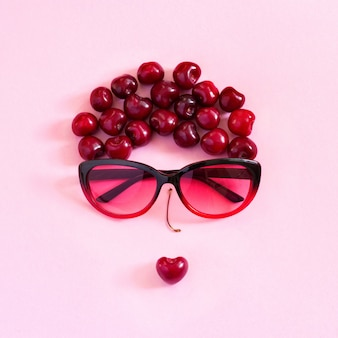 Abstract image young woman from sweet cherry and glasses. concept