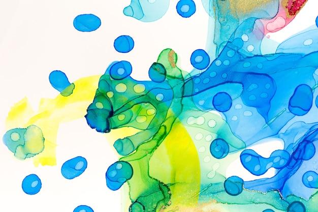 抽象的なインク青と緑の水彩インクスポット背景アルコールインクイラスト