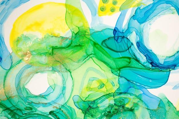 Абстрактные чернила синие зеленые и желтые акварельные чернила капли фон спиртовые чернила