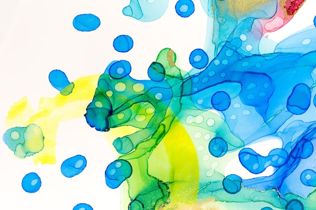 Abstract ink blue and green watercolor ink spots background alcohol ink illustration