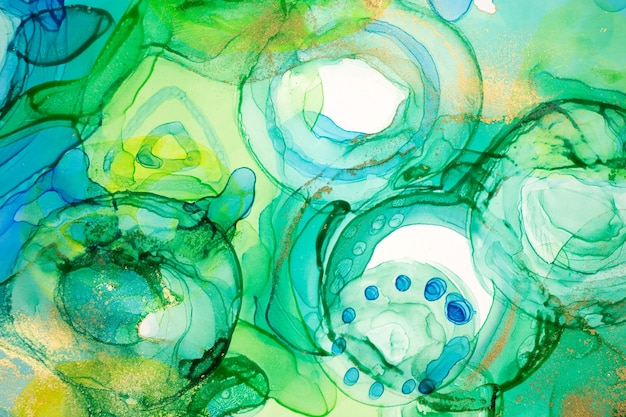 Abstract ink blue green and yellow watercolor ink drops background alcohol ink illustration