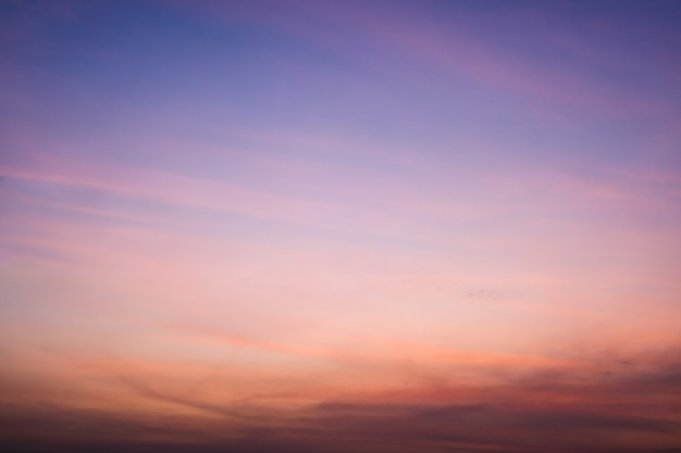 Abstract landscape nature background of sky with clouds in sunset.