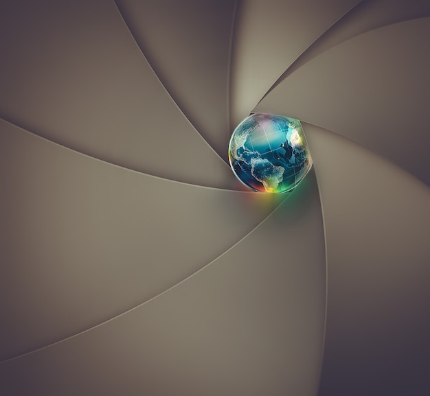 Abstract lens shutter with the world in the center conceptual image of a photograph nasa maps were u...
