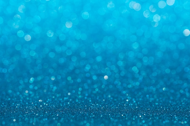 Abstract light blue sparkling glitter wall and floor perspective background studio with blur bokeh