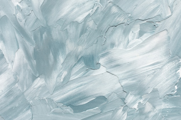 Abstract light blue and white rough concrete wall or stucco texture background