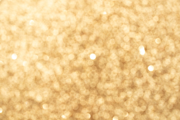 Abstract light bronze blurred bokeh background. glitter shining lights. festive and celebration backdrop for holiday, christmas and new year design, stock photo