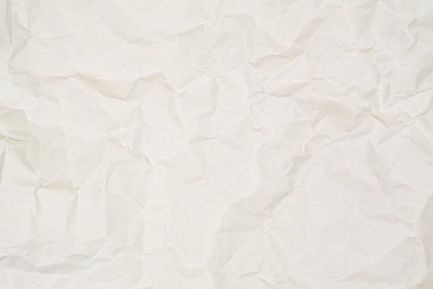Abstract light brown white crumpled paper texture background