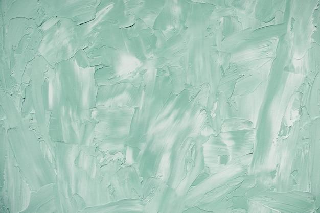 抽象的な薄緑と白の大まかなコンクリート壁または漆喰のテクスチャ背景
