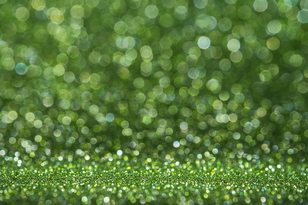 Abstract light green sparkling glitter wall and floor perspective background studio with blur bokeh