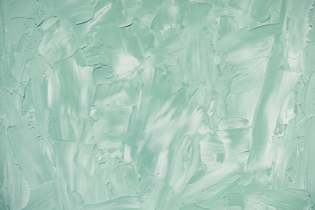 Abstract light green and white rough concrete wall or stucco texture background