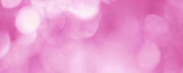 美しいボケ味の効果を持つ抽象的な淡いピンクの背景は、愛の日の背景に最適です