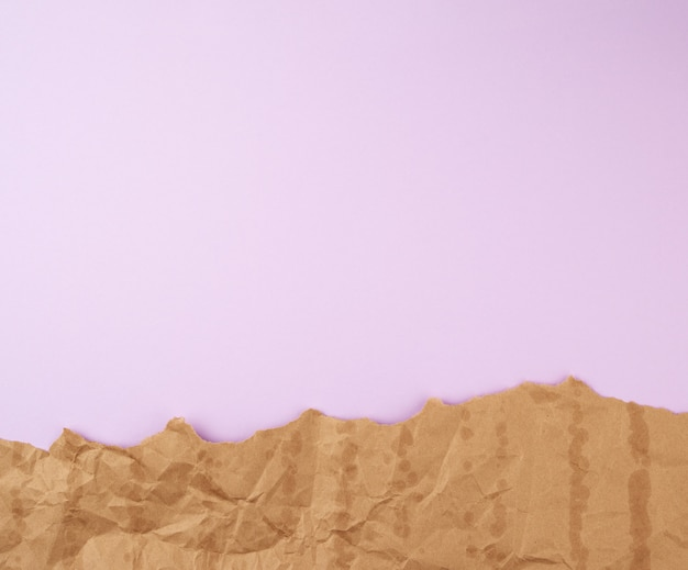 Abstract lilac surface with brown torn paper elements