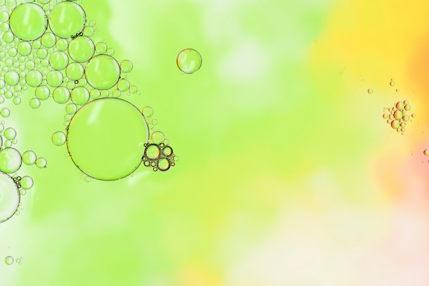 Abstract liquid drops on green background