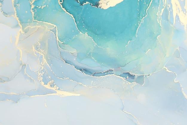Абстрактный фон жидкой туши в пастельных тонах с золотыми вкраплениями