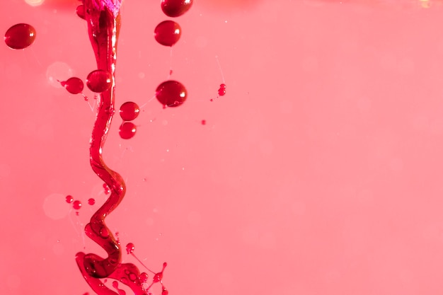 Abstract liquid slime on pink surface