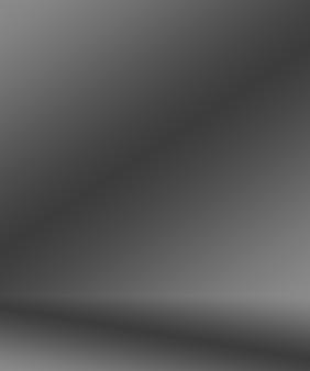 あなたの製品を表示するための背景のスタジオの壁として使用される、抽象的な贅沢なぼかしダークグレーと黒のグラデーション。