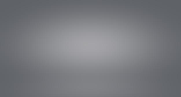 Sfocatura di lusso astratta sfumatura di colore grigio, utilizzata come parete dello studio di sfondo per visualizzare i tuoi prodotti. Foto Gratuite