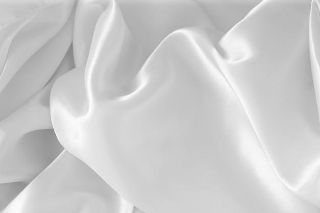 Абстрактная роскошная белая текстура сатиновой ткани для дизайна фона, ткань для фона.
