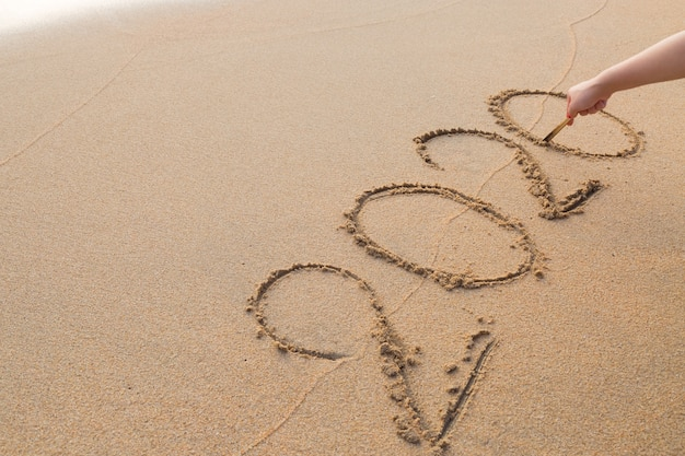 Abstract message year 2020 written on beach sand background
