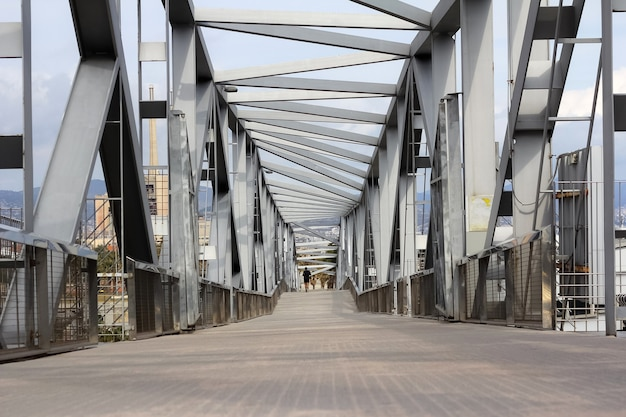 Abstract metal bridge structure going into perspective in barcelona, spain.