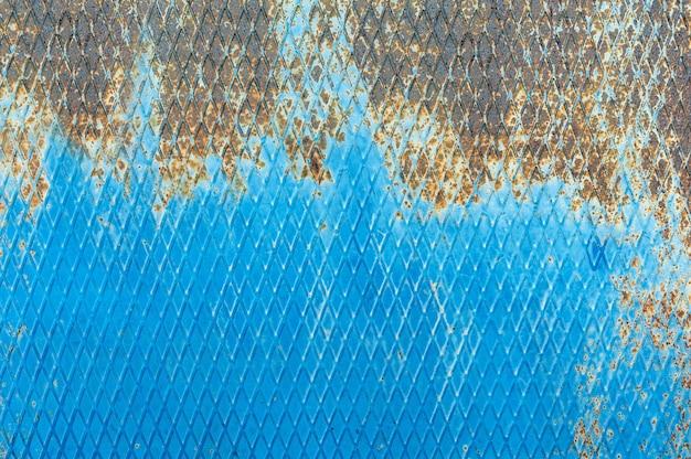 추상 금속 질감 배경입니다. 푸른 색의 녹과 흙이 있는 오래된 표면.