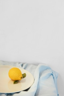 Abstract minimal concept lemon and plates Free Photo