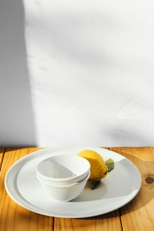 Abstract minimal concept lemon and plates Free Photo
