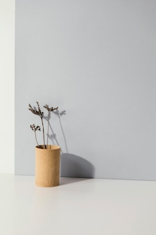 Abstract minimal plant in a vase copy space