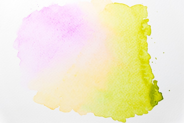 Abstract mixed pink, yellow and green watercolor on paper