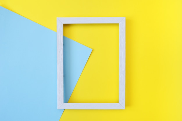 Abstract mock up with white wooden frame on yellow and blue