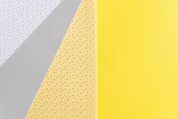 Абстрактный современный бумажный фон ручной работы в идеальных серых и ярких желтых модных тонах