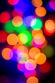 Abstract multi-colored bokeh on a black background.