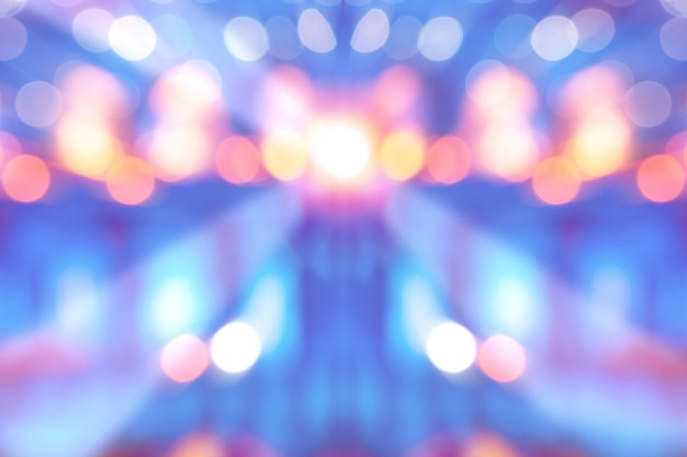 Abstract multi-colored light background with defocused bokeh light, the stage of the entertainment show