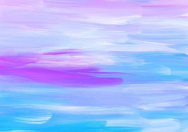 Абстрактный разноцветный фон, мазки кистью синий, розовый, белый на бумаге
