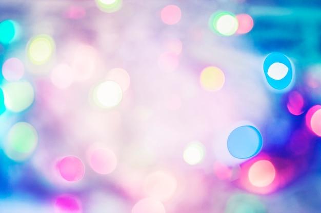 抽象的な色とりどりの焦点ぼけライトお祭りの背景