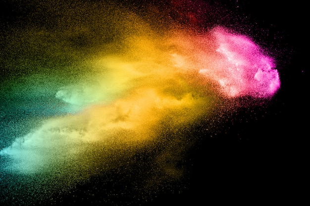 Abstract multicolored dust explosion on black background.