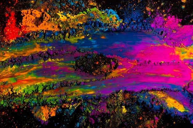 Abstract multicolored holi powder explosion on black background