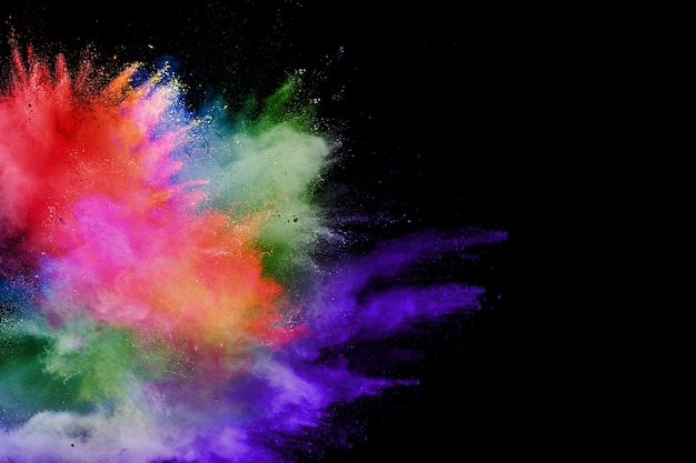Abstract multicolored powder explosion on black background.