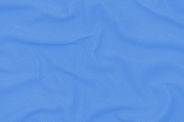 Abstract neon blue fabric texture background. cloth soft wave. close up, draped.