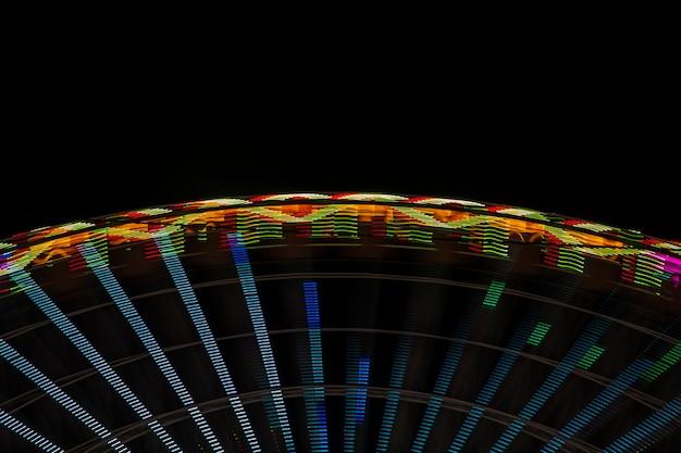 Luci al neon astratte su una ruota di meraviglia