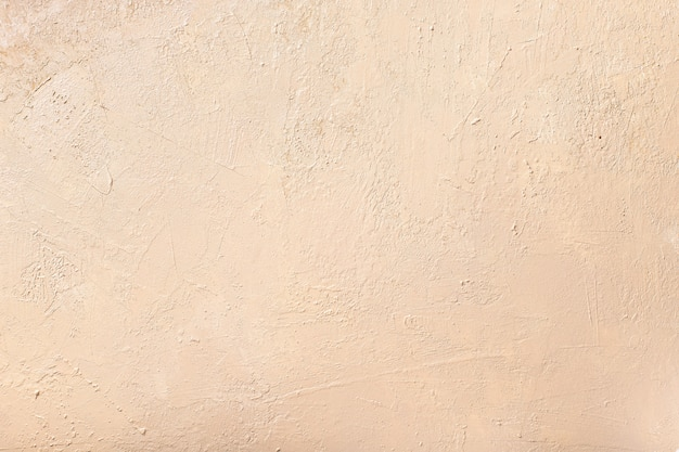Abstract neutral beige wall. textured background. selective focus.