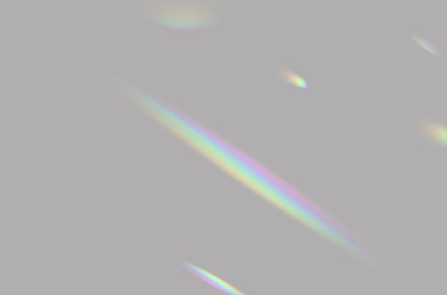 모형 및 장식용 회색 배경에 흐릿한 무지개 프리즘 조명 오버레이의 추상