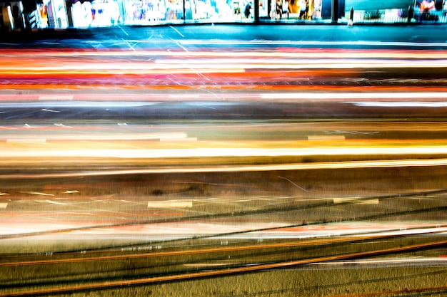Аннотация разноцветных огней городского света в движении