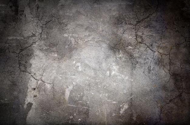 금이 간 더러운 콘크리트 벽의 질감이 있는 추상 오래된 회색 그루지 배경
