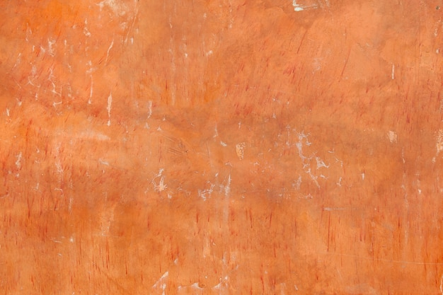 Abstract old orange cement wall with crack texture and background