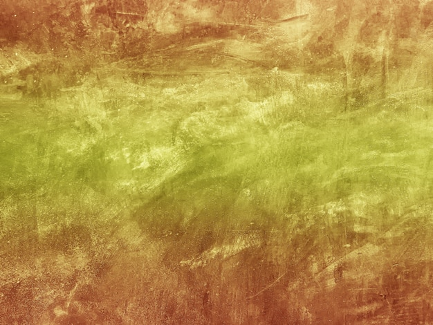 Abstract orange color of grunge texture of cement wall background.