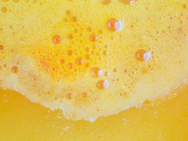 Abstract orange foam of effervescent water
