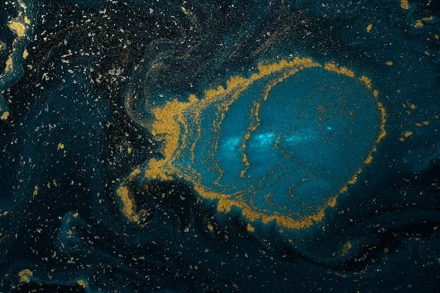 Abstract paint texture art. natural luxury. blue paint with gold glitter powder. marble.