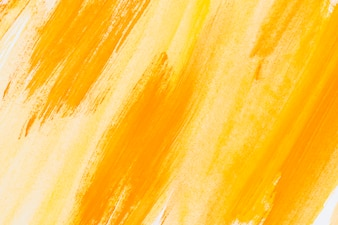 Abstract painted yellow watercolor background on paper texture